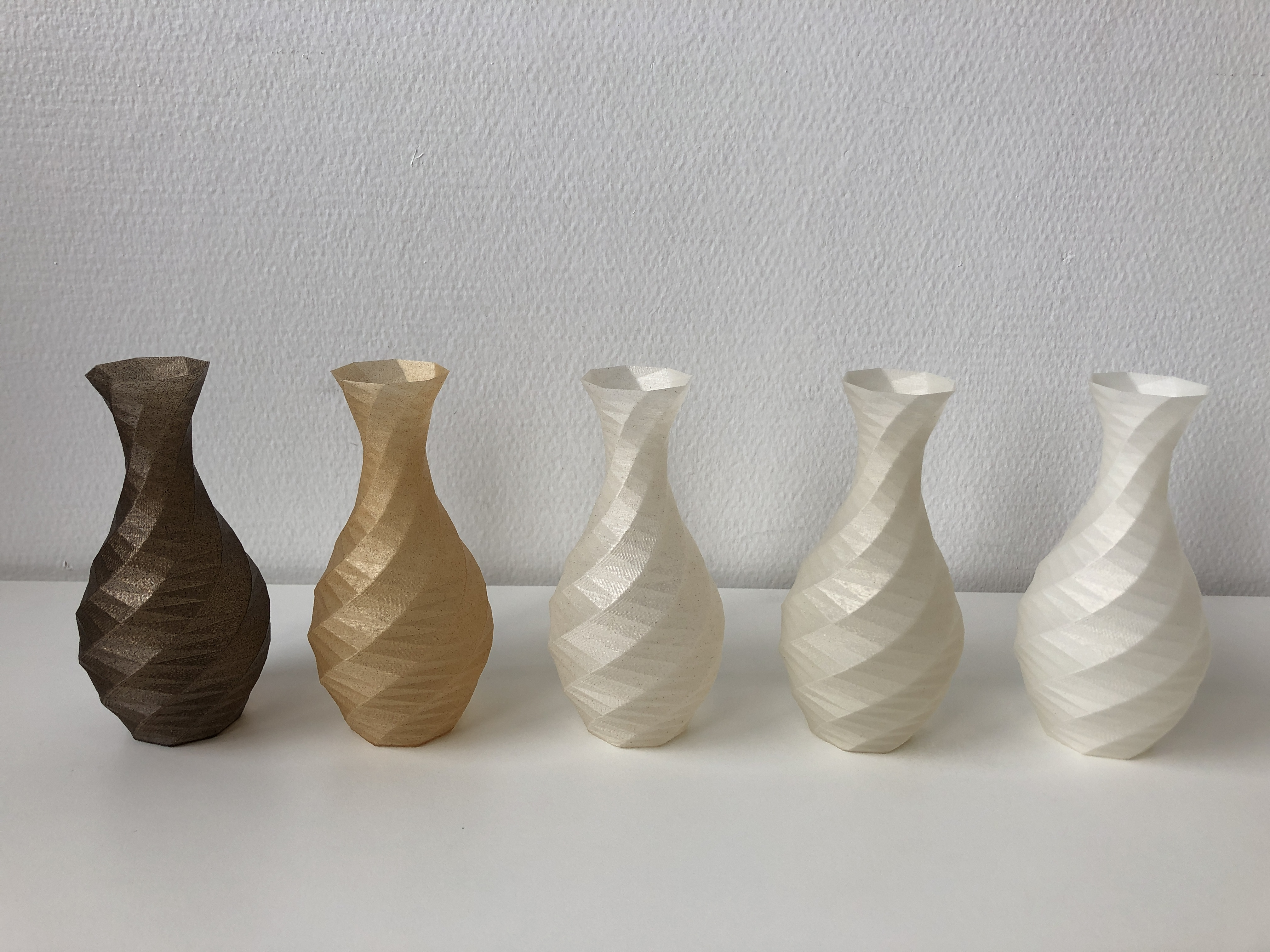 Vases printed with biocomposed filaments.