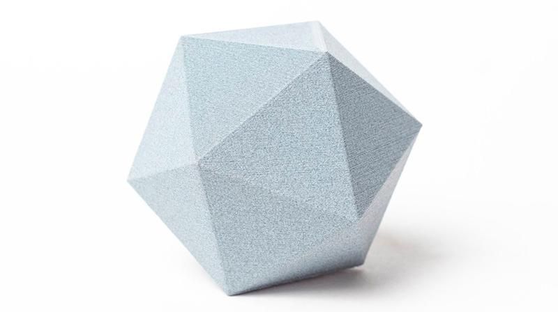 Pieza impresa con PLA Fibra de carbono gris claro.