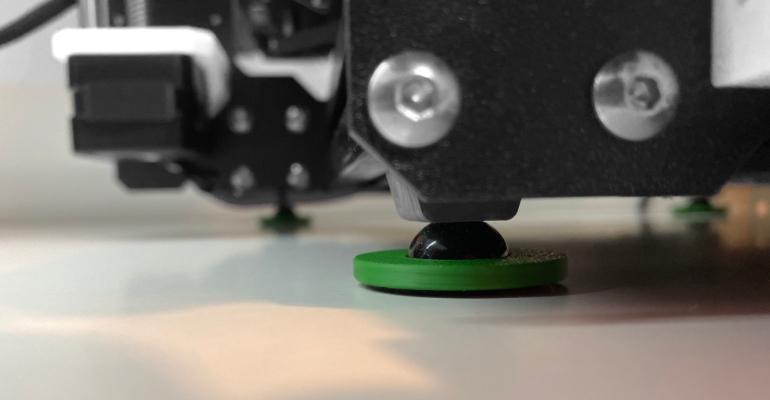 Detail of pad installed under a 3D FDM printer.